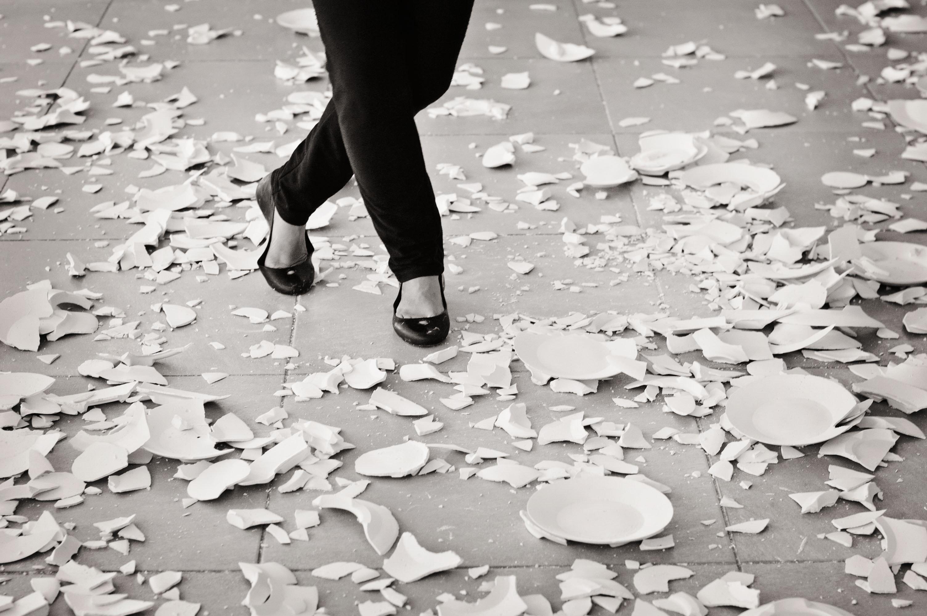 grayscale-of-woman-in-black-flat-sandals-walking-803951